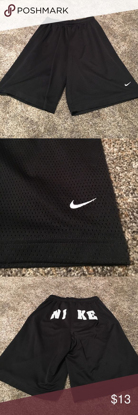 Black Nike Shorts Nike black and white mesh shorts are in excellent condition! Nike is spelled out on the butt. 100% polyester. Nike Bottoms Shorts