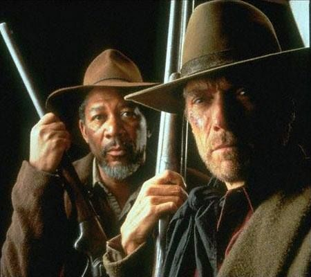 Clint Eastwood and Morgan Freeman in The Unforgiven… the guns create a little bleed-off in the composition but it can make a triangle if the border is right, like the drama created with strong light difference….wdk
