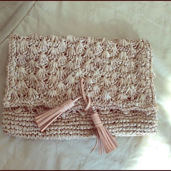 RAFFIA CLUTCH BAG- NWOT Raffia type woven clutch bag. Never used. Very cute for summer. LEATHER trim. Bought in Bali. Bags Clutches & Wristlets