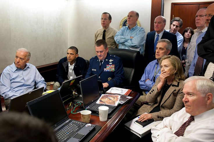 """President Barack Obama and Vice President Joe Biden, along with members of the national security team, receive an update on the mission against Osama bin Laden in the Situation Room of the White House, May 1, 2011. Seated, from left, are: Brigadier General Marshall B. """"Brad"""" Webb, Assistant Commanding General, Joint Special Operations Command; Deputy National Security Advisor Denis McDonough; Secretary of State Hillary Rodham Clinton; and Secretary of Defense Robert Gates. Standing, from…"""