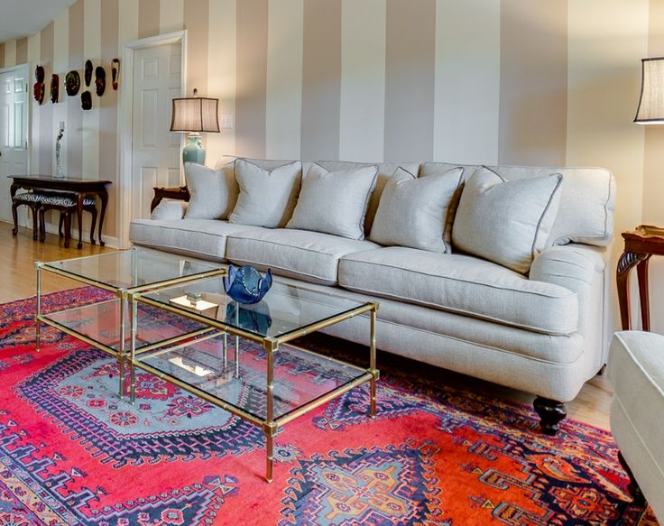 Living Room With Persian Rug And African Masks