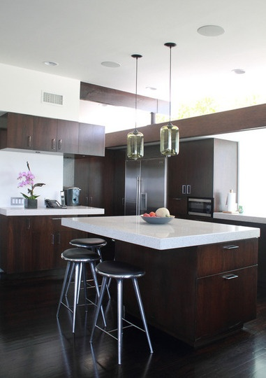 lovely kitchen - wood + white counter + great glass lights