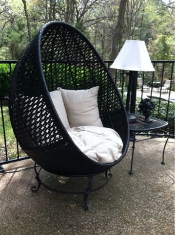 A Hanging Chair Converted To A Lounge Chair With A Firepit Stand.