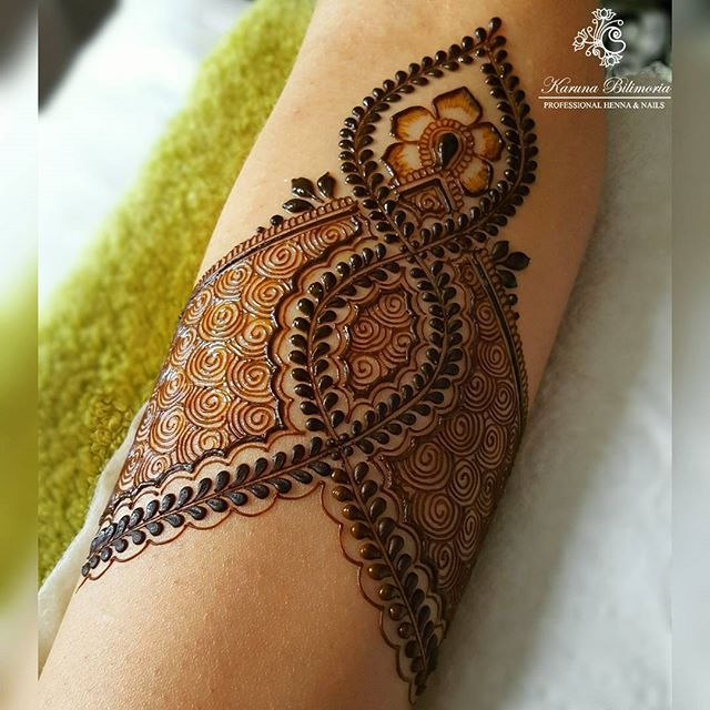 Maybe tie in a zipper instead of the leaf pattern. zipper and lace henna