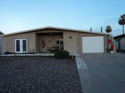 Mesa Arizona Adult Community Homes For Sale  $208,500, 2 Beds, 1 Baths, 1,555 Sqr Feet  SIMPLY STUNNING! MODEL PERFECT! MUST SEE! Open concept floor plan! Beautiful new kitchen includes upgraded cabinets with pull out drawers, marble tile counter tops, glass back splash, pantry area with mini fridge! Formal dining room. Gas fireplace in living room. Office space. Craft room. Sunroom! NA complete and FREE UP-TO-DATE list of Phoenix homes for sale in Adult Communities!  http://mikebr..