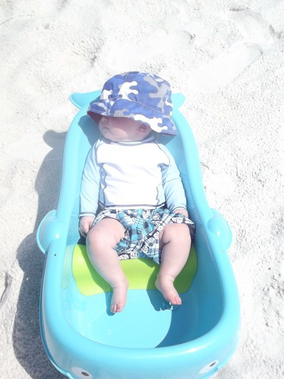Tips for a Baby at the Beach. This lady is genius! Bringing a baby tub to fill with ocean water is so smart!