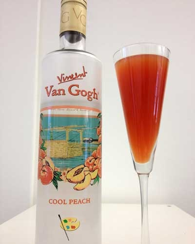 Passion Peach Punch with Van Gogh Cool Peach Vodka, cranberry juice, and mango juice. Chill over ice cubes made from cranberry juice and mango juice.
