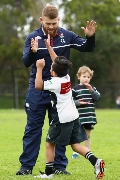 Luke Cowan-Dickie Photos Photos - Luke Cowan-Dickie of England high fives kids whilst playing a game of touch during a visit to Powerhouse Rugby Club on June 18, 2016 in Melbourne, Australia. - Wallabies & England Players Visit Powerhouse Rugby Club