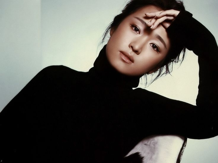 Stunning Chinese Gong Li ...  Stylish sex icon...   She has twice been awarded the Golden Rooster and the Hundred Flowers Awards as well as the Berlinale Camera, Cannes Festival Trophy, National Board of Review, New York Film Critics Circle Award, and Volpi Cup.
