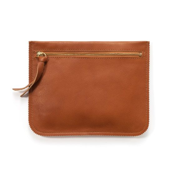 The Zig Pouch in Brown  I designed the Zig Pouch to be classic with a twist! It is perfect to hold all your little items.  The pouch is made from high