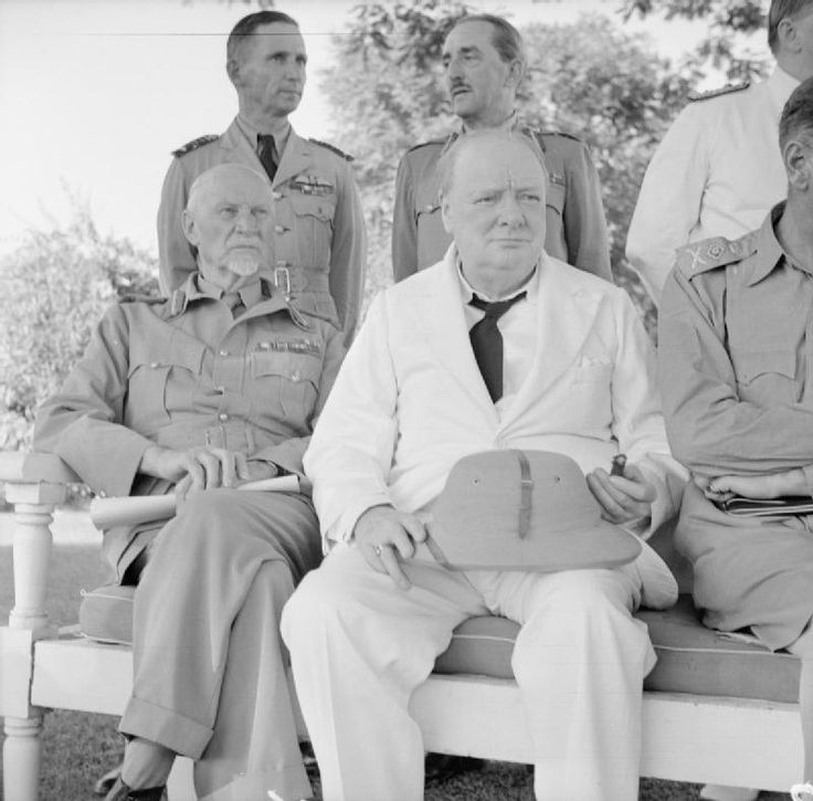 BRITISH ARMY NORTH AFRICA 1942 (E 15223)   Winston Churchill with Field Marshal Smuts and behind, Sir Arthur Tedder (left) and Sir Alan Brooke, at the British Embassy in Cairo, 5 August 1942.