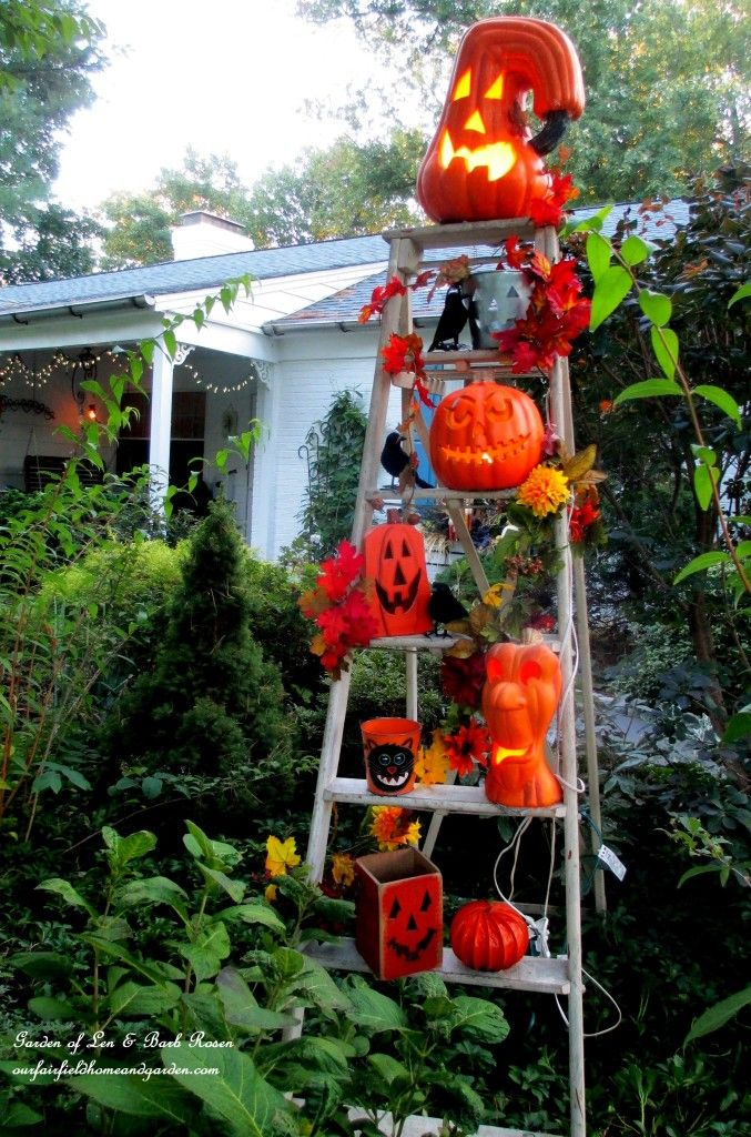 Lighted jack o 39 lanterns on the pumpkin ladder http Fall outdoor decorating with pumpkins