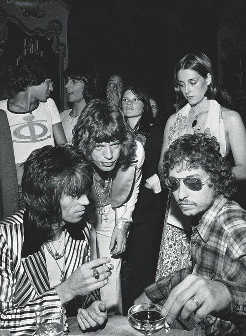 Keith Richards, Mick Jagger, Bob Dylan, Jagger's 29th birthday party in July 1973 photographed by Ken Regan