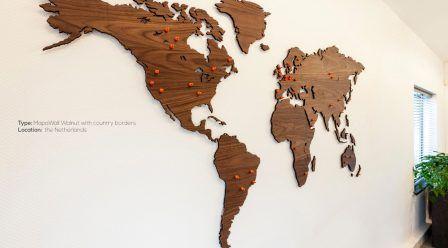 Walnut-wooden-world-map-with-orange-pinpoints