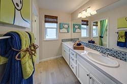 Spacious bathroom in the Alder plan at East Garrison. Part of our Grove collection of town home style condominiums in Monterey County, CA