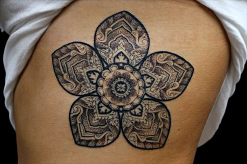 Flower tattoo. love the detail.in white on the top of my shoulder onto my arm