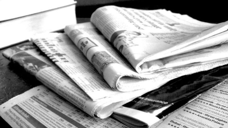Line Your Trashcan With Newspapers to Absorb Gross Drips