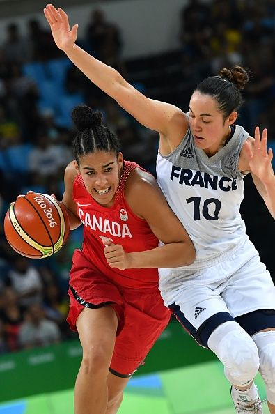 Canada's guard Kia Nurse works around France's shooting guard Sarah Michel…