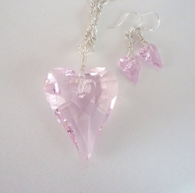 Large Swarovski crystal heart sterling silver necklace and earrings. Prices from £40  #jewellery #silver #swarovski #jewelry #jewellery making #crystal #wedding #gift #giftidea http://pict.com/p/Yl