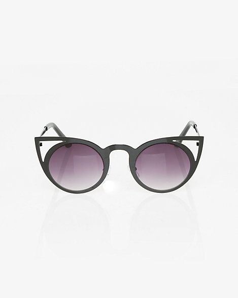 Metal Sunglasses - Get ready for sunny days with these chic metal sunglasses designed with dark, circular lenses.