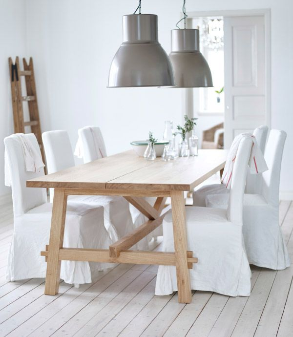 Delightful A Dining Table In Solid Oak Shown With Six Dining Chairs Covered With White  Long Covers. Lighting Over Dining TableIkea ...