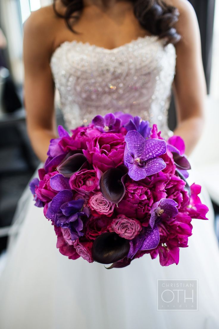 I love this vibrant bridal bouquet with pinks and purples and vanda orchids.  Jen, Flowers by Suzanne