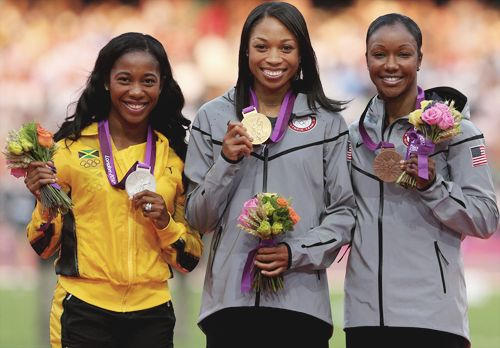 Silver medalist Shelly-Ann Fraser-Pryce, gold medalist Allyson Felix, bronze medalist Carmelita Jeter during the medal ceremony for the Women's 200m today