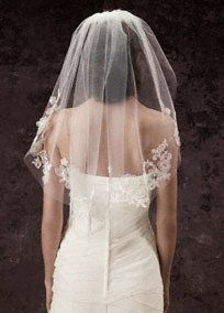 """White by Vera Wang veil evokes an air of romance for your walk down the aisle.   Single-tier cage veil with appliqued lace and three-dimensional floral detailing.  Veil measures 28"""" in length and 50"""" in width.  Available in stores and online.  Imported."""