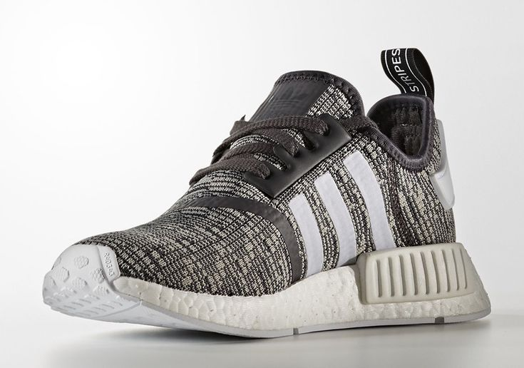 The adidas NMD R1 Glitch Camo will release this December 2016 in a women's exclusive size run featuring grey and black Primeknit. Style Code: BY3035