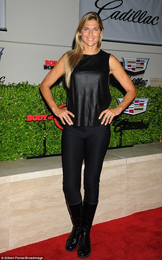 Keeping it simple: Professional volleyball player and sports announcer wore an all-black l...