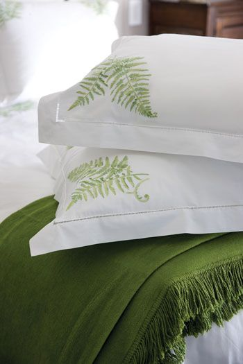 Charlotte Moss bed linens, with a crisp green-and-white fern print, are perfect for my guest room!