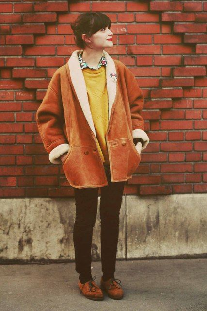tan shearling jacket, sweater with relaxed buttonup, skinnies and oxfords