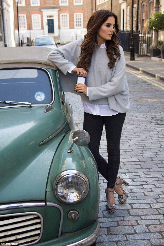 Binky strikes a pose in an out-sized cashmere jumper worn over a white shirt, black trousers and heels