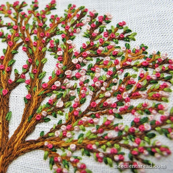 Hand Embroidered Tree, Blooming, worked with split stitch, seed stitch, and French knots.  Mary Corbet, Needle n Thread