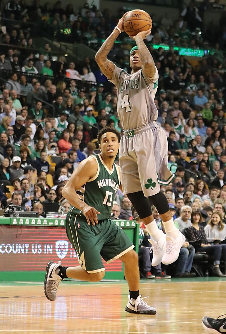 Boston MA 4/12/17 Boston Celtics Isaiah Thomas knocks down a 3-point basket beating Milwaukee Bucks Malcolm Brogdon during second quarter action at TD Garden. (Photo by Matthew J. Lee/Globe staff) topic: reporter: