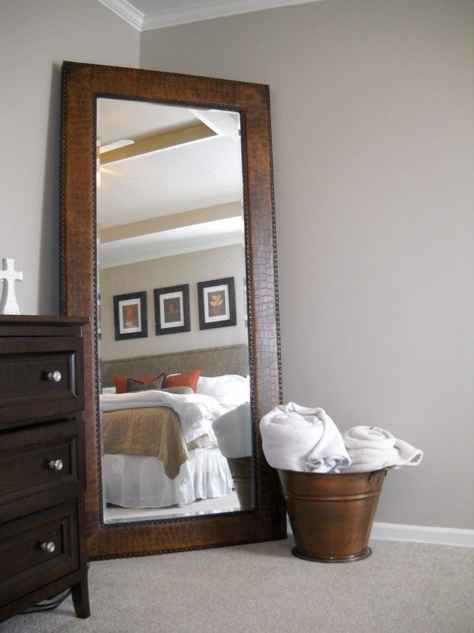 Leaner Mirror With Brown Wooden Frame On Wheat Floor Matched With Wheat Wall Plus Wooden Dresser Ad White Bedding For Bedroom Decor Ideas