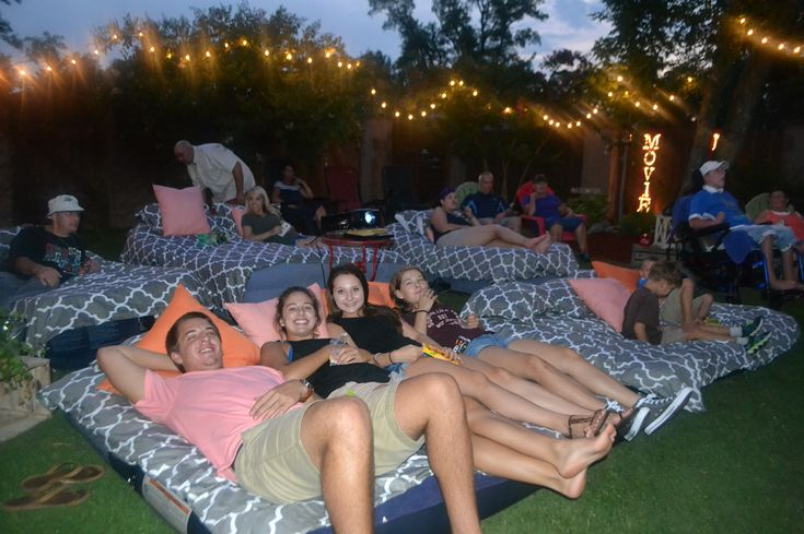Outdoor movie night with air mattresses