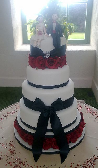 Wedding cake-not big on the black bow in the middle-maybe another small one on the bottom, like the one on top