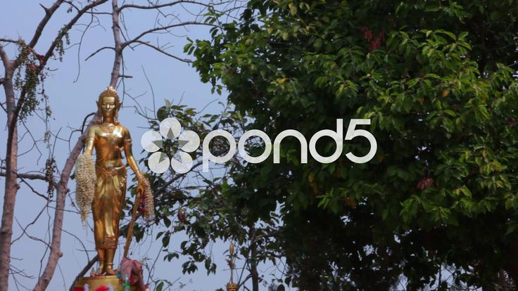 Gold Statue In Buddhist Thai Temple Religious Worship Trees  Monument - Stock Footage | by RyanJonesFilms #thailand #buddha #buddhist #temple #statue #belief #religion #religious #worship #travel #culture #sightseeing #tourist #demon #art #prayer #asia #monk #thai #gold #buddhism
