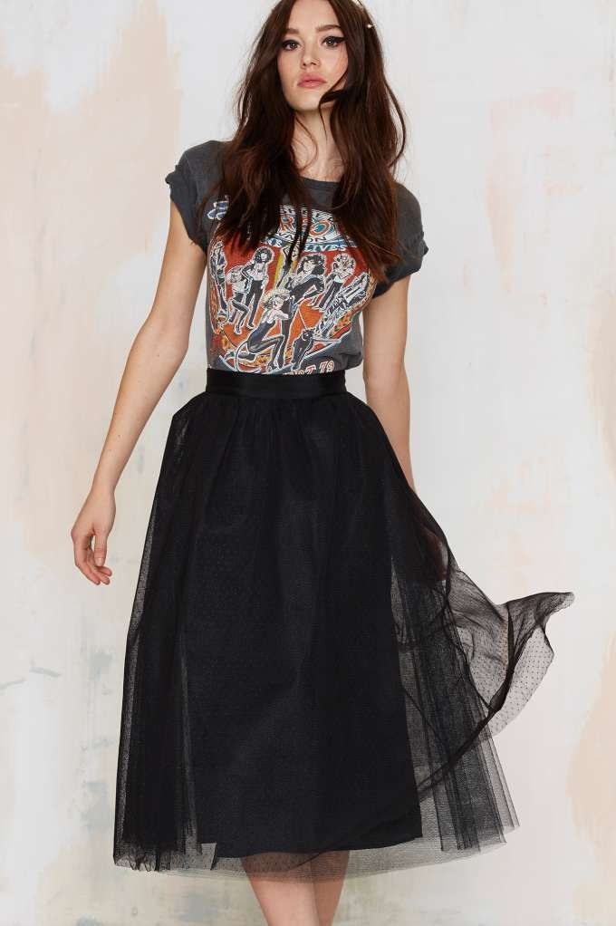 A tulle skirt with a great white oxford and tie would create an equally balanced masculine and feminine look.