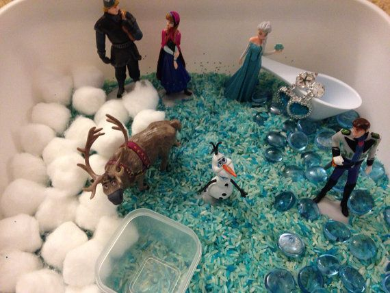 Frozen Sensory bin with figurines rice and bin. Easy enough to make yourself. Great idea for role play and CL development