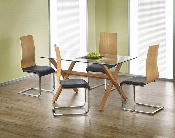 Krzesło K222 jest nowoczesnym i nietypowym krzesłem idealnym do salonu lub jadalni. Siedzisko jest pokryte miękką skórą ekologiczną, natomiast oparcie to gięta sklejka laminowana.
