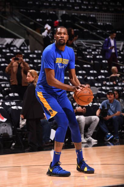 70c14b0fad6f Kevin Durant of the Golden State Warriors warms up before the game against  the San Antonio Spurs in Game Three of Round One of the 2018 NBA Playoffs.