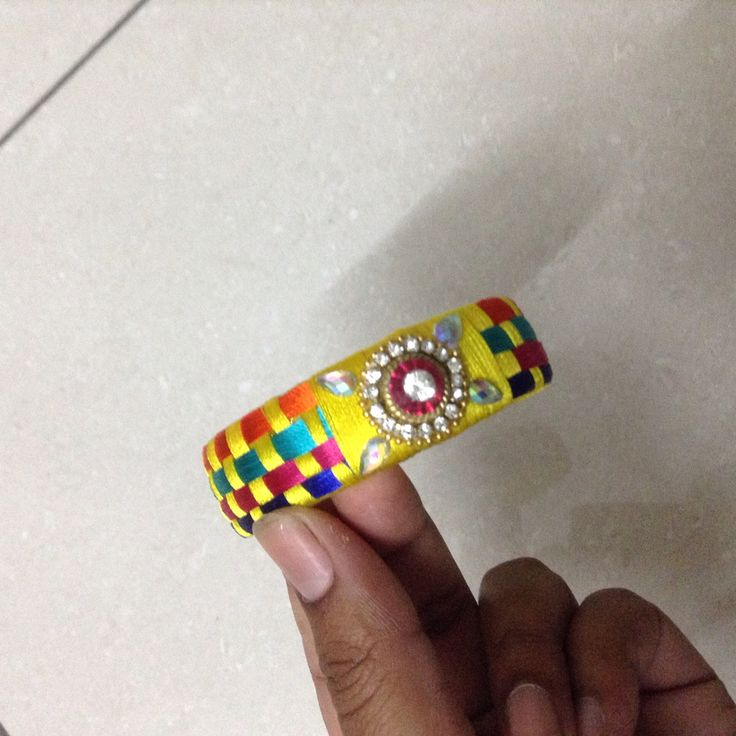 Multi coloured bangle made with silk thread
