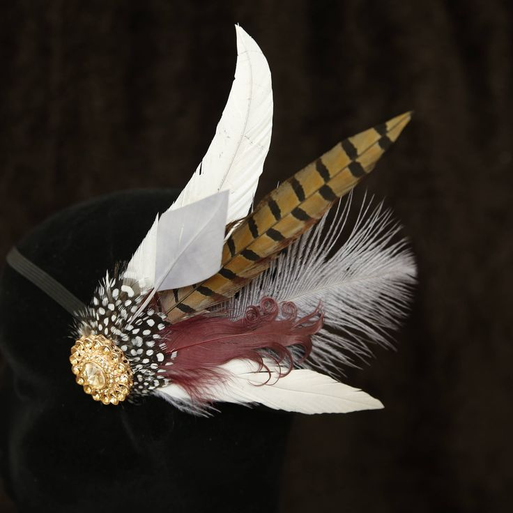A personal favourite from my Etsy shop https://www.etsy.com/uk/listing/526704927/feather-fascinator-for-weddings-parties