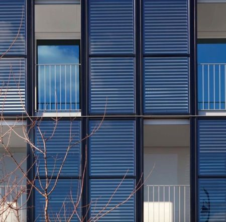 Philippon-Kalt Eco Architecture - Solar panels in the facade produce warm water for inhabitants of this building