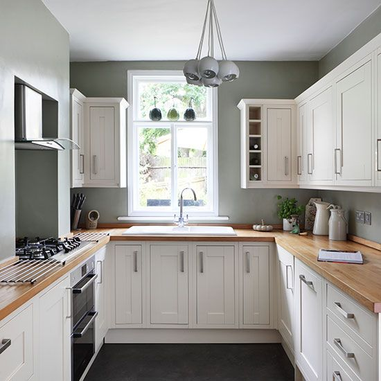 Ideal Kitchens U Shaped Kitchen with White Cabinetry also Wooden Worktop plus Gray Pendant Light and