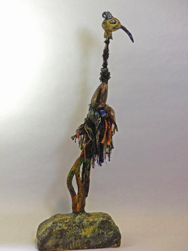 """AN UNUSUAL BIRD Polymer clay, paper clay, branch, wire, fiber & acrylic paint 25"""" high 9"""" wide 4"""" deep"""