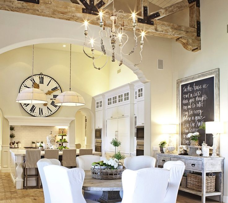 LOVE this French dining room with vaulted ceiling, rustic wood beams, gray washed buffet. My favorite is the very large wall clock over the stove in open kitchen.