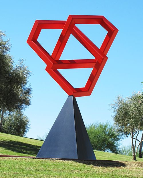 """Top Knot is a public art sculpture by artist Kevin Caron. It was commissioned by the city of Surprise, Arizona, and is installed at its civic center plaza. powder-coated steel, 108"""" x 56"""" x 56"""""""